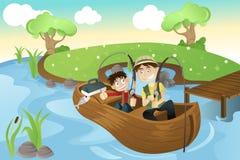 父亲捕鱼去的儿子 免版税库存照片
