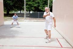 父亲raquetball儿子 免版税库存图片
