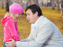 爸爸女儿后悔 免版税库存照片