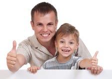 爸爸愉快的儿子 免版税库存照片