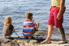 爸爸捕鱼开玩笑三 免版税库存图片