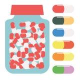 片剂的瓶,包装为片剂,药片的容器,上色了药片 免版税库存图片