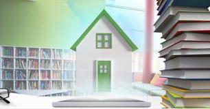 片剂的绿色屋顶房子在学校的书桌上 库存例证