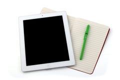 片剂笔记本和铅笔 库存照片