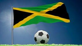 牙买加旗子振翼和橄榄球卷 皇族释放例证