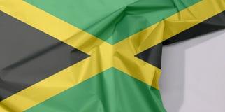 牙买加织品旗子绉纱和折痕与白色空间 免版税库存照片