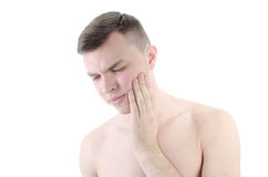 牙痛 有蛀牙的年轻人 免版税库存图片