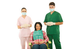 牙科医生耐心的微笑的妇女 免版税库存图片