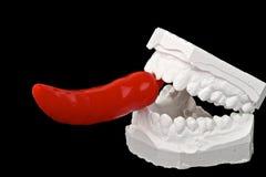 牙齿印象用炽热辣椒 免版税库存图片