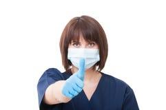 牙医显示翘拇指的妇女医生 免版税库存照片