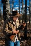 牛仔他的步枪 库存图片