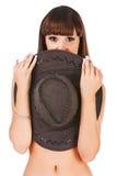 牛仔女孩新帽子的toples 库存图片