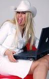 牛仔女孩膝上型计算机 免版税图库摄影