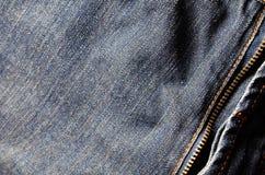 牛仔布与拉链的牛仔裤背景 免版税图库摄影