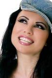 牛仔布女性帽子微笑 免版税库存照片