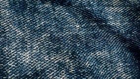 牛仔布织品织地不很细蓝色振翼 帆布的动画运动 振翼在的牛仔裤的背景动画 免版税库存照片