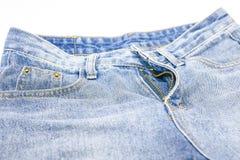 牛仔布裤子,打破的拉链裤子 图库摄影