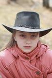牛仔帽的女孩 免版税库存照片