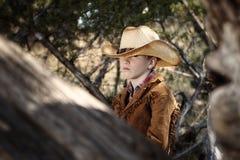牛仔成套装备的男孩 免版税图库摄影