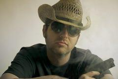 牛仔枪帽子藏品人 库存照片