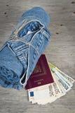 牛仔裤、护照和货币 库存照片