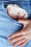 牛仔裤口袋卢布 免版税图库摄影
