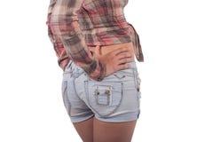 牛仔裤的逗人喜爱的女孩短缺 图库摄影