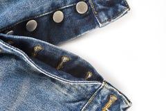 牛仔裤的飞行有按钮关闭的 免版税图库摄影