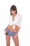 牛仔裤短裤妇女年轻人 免版税图库摄影