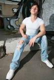 牛仔裤被撕毁的青年时期 免版税库存图片