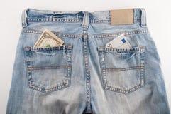 牛仔裤货币 免版税库存照片