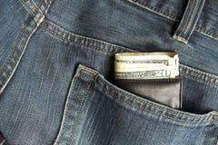 牛仔裤钱包 免版税库存照片