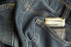 牛仔裤钱包 免版税库存图片