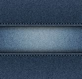 牛仔裤镶边与针 免版税库存照片