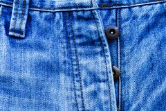 牛仔裤长裤的零件 免版税库存图片