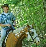 牛仔马骑术 免版税库存图片