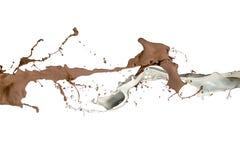 牛奶和液体巧克力飞溅 免版税图库摄影