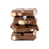 牛奶巧克力用整体榛子 免版税库存图片