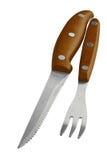 牛排扁平的餐具设置了-利器-牛排餐刀和叉子与木把柄 免版税库存照片