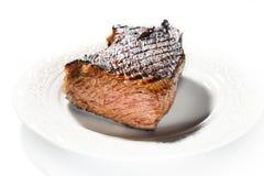 牛排用在一块板材的芳香草本在白色背景 免版税图库摄影