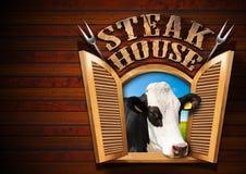 牛排餐厅-与母牛的窗口 库存图片