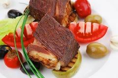 牛肉烤和被装饰的小腓厉牛排 免版税库存照片