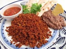 牛肉辣加调料的口利左香肠的正餐 免版税图库摄影