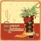 牛仔与文本和起动的圣诞卡 免版税库存照片