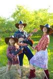 牛仔可笑的家庭  图库摄影