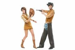 牛仔和女牛仔有枪的 免版税库存图片
