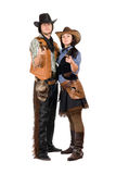 年轻牛仔和女牛仔有的枪 库存图片