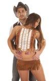 牛仔和她在前面手鼓起的印地安妇女 库存照片