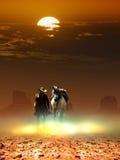 牛仔和马在太阳下 免版税库存照片