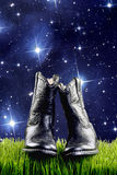 牛仔靴在晚上 免版税图库摄影